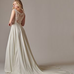 Woman in Lydia fair trade wedding dress bridal gown with lace back